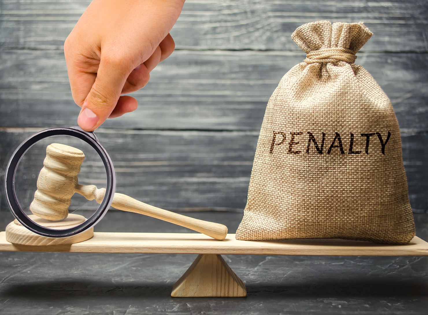 Bag,With,The,Word,Penalty,And,Gavel,On,The,Scales